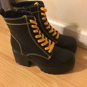 Black and yellow platform boots